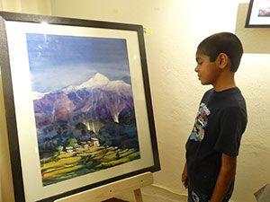 Audience awed by the painter Rajendra Poudel's reflection on the Himalayas