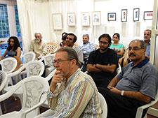 Patrons in awe of Mukta's work.