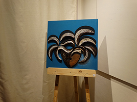Terracotta masks on hand-painted boards by Rashmi Bhadkamkar