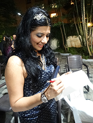 Reshma signed books for the readers after the launch
