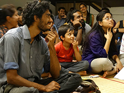 "The audience enjoying folk tales ""Kotraene, The Reluctant Hero: The Todas of The Nilgiris"""