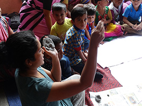 Rashmi shows the children how to be cretive with clay