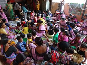 The anganwadi sevikas guide the children
