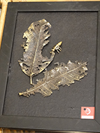 Real leaves are cast in a metal mold to create unique, original art.