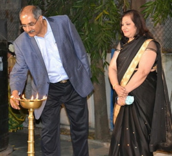 Mr. and Mrs. Merchant, the managing trustees of Gyaan Adab light the auspicious lamp