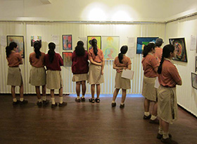 Orchid sch - Students from Orchid school engrossed in the art work on display
