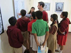 Kalmadi - Sam explains his work to the students of Kalmadi School