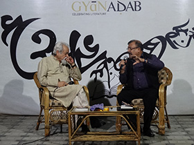 Randhir Khare and Dilip Mohapatra discussing poetry and literature
