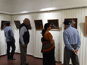 Patrons admiring the art work