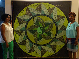 Artist Karlette Joseph with her mandala - 'Lost in Green'