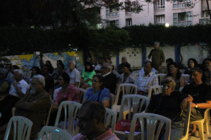 The audience watch 'The World in a Story' animatedly.