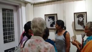 Pooja explains her art.
