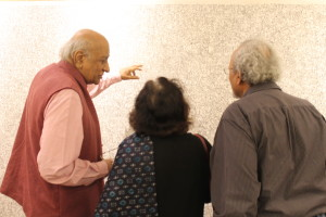 Patrons discuss the meaning behind art.
