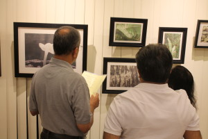 Visitors look at Pankaj's work of the Islands.